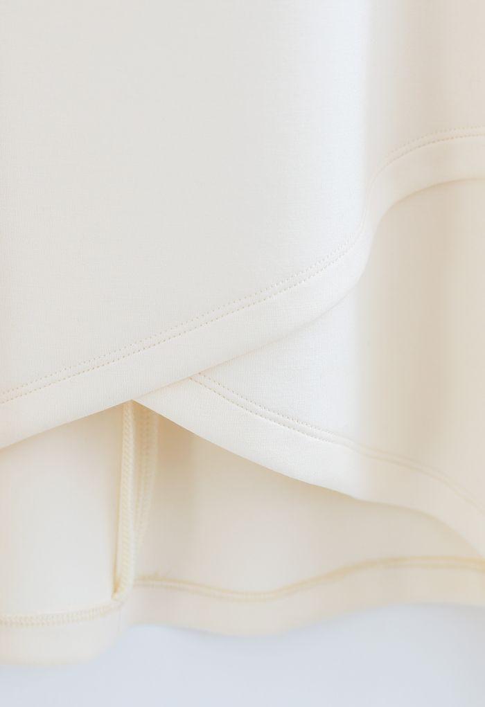 パーリーネッククロスラップ裾プルオーバー アイボリー