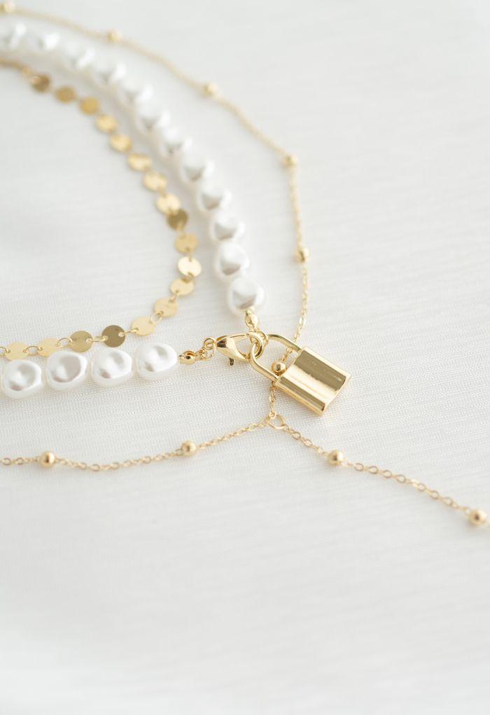 マルチレイヤーコインパールゴールドロックネックレス